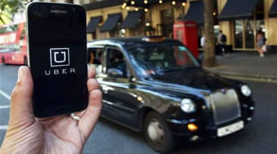 Uber said it will challenge the decision to strip it of its licence [Neil Hall/Reuters]