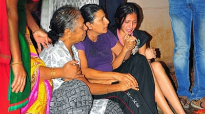 Unidentified relatives mourn Lankesh's death in Bangalore [AP]