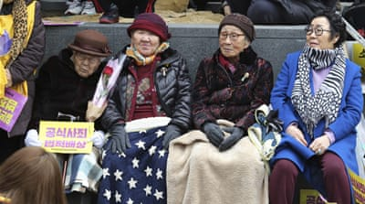 Former 'comfort women' attend a rally in Seoul last March [Ahn Young-joon/AP]