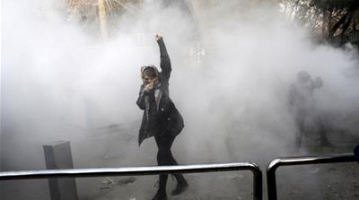 Why did protests erupt in Iran?