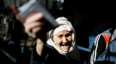 US cuts UNRWA funding by more than half