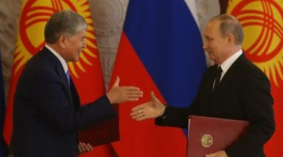 Putin and president of Kyrgyzstan meet at CIS June '17 [Getty Images]