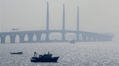 China's president opens long-delayed southern sea bridge