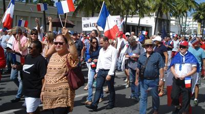 New Caledonians vote to stay French in tense referendum
