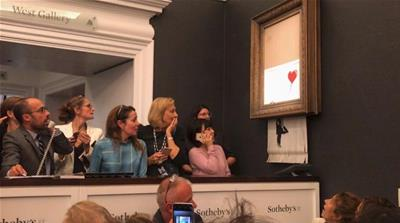 Banksy painting self-destructs after $1.4m sale
