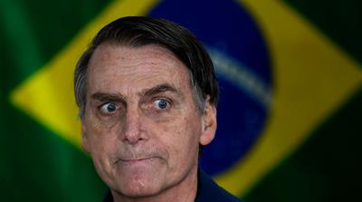 Jair Bolsonaro is a far-right firebrand and self-styled political outsider [Mauro Piemtel/AFP]