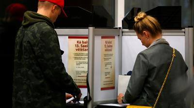 Latvians vote to elect new parliament