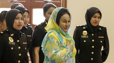 Malaysia charges former PM's wife in corruption case