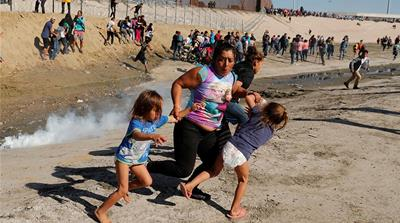 US briefly shuts border crossing, uses tear gas on asylum seekers