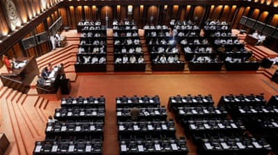 Sri Lanka MPs vote to block cash flow to office of disputed PM