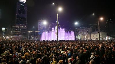 Demonstrators at an anti-government protest in central Belgrade [Marko Djurica/Reuters]