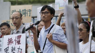 Hong Kong pro-democracy legislator barred from local election