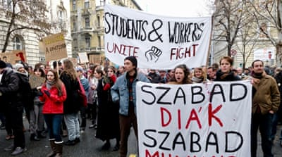 Hungarian workers protest over 'slavery law', students join in