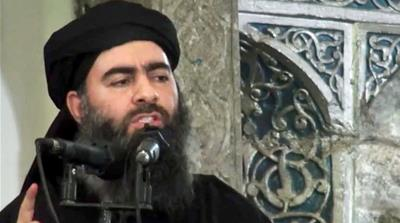 ISIL chief Abu Bakr al-Baghdadi was reportedly wounded in an air raid [Screengrab via AP]
