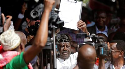Kenyan opposition leader Raila Odinga takes a symbolic presidential oath in front of his supporters and members of the media in Nairobi, Kenya on January 30 [Thomas Mukoya/Reuters]