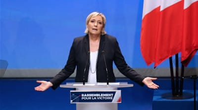 Marine Le Pen severs ties with founder, announces name change