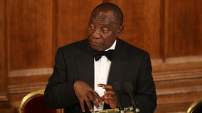 S Africa's Ramaphosa cuts short UK trip over violent protests