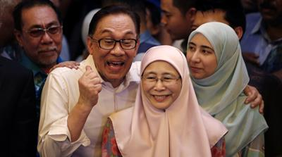Anwar was jailed for five years in 2015 after being accused of sodomy, a charge he described as a politically motivated [Reuters]