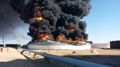 Libya clashes at oil ports cut output by nearly half