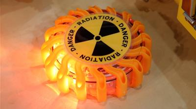A radioactivity symbol is pictured at the World Nuclear Exhibition (WNE) [Benoit Tessie/Reuters]