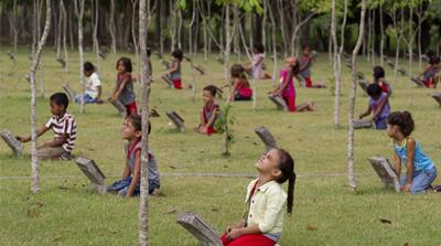 School children take part in an outdoor class about native Amazon trees in Paragominas, Brazil's first 'Green City', whose progressive policies have stopped illegal deforestation [AP]