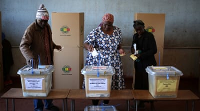 Zimbabwe elections: Voters cast ballots in landmark polls