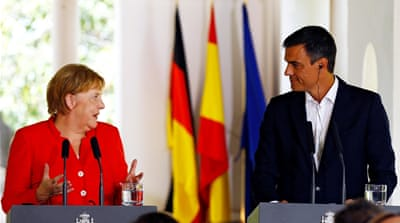 Spain, Germany leaders pledge to work together on migration