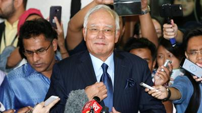 It took three days and six cash-counting machines to tally the money found at Najib's homes [Lai Seng Sin/Reuters]