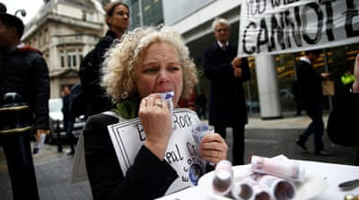 London climate change activists zero in on BlackRock
