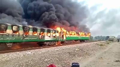Dozens killed in gas canister blast and fire on Pakistan train