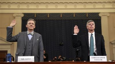 Career Foreign Service officer George Kent and top U.S. diplomat in Ukraine William Taylor, right, are sworn in to testify during the first public impeachment hearing of the House Intelligence Committ