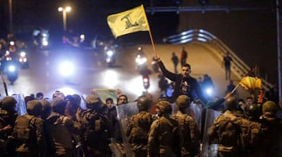 Lebanon protesters and Hezbollah, Amal supporters clash in Beirut