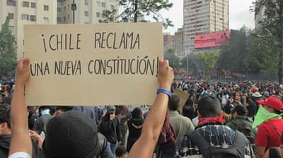 Chile protests: Chileans demand new constitution amid unrest