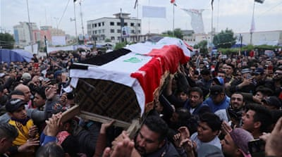 Iraqis rally for slain activist as Baghdad summons Western envoys