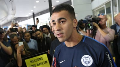 'A victory!': Jubilation as freed footballer returns to Australia
