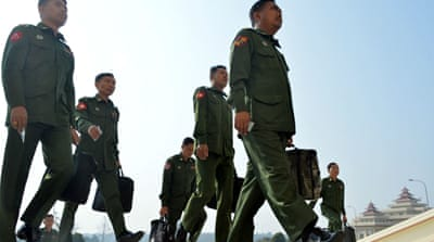 Myanmar government ups the ante with military over political role