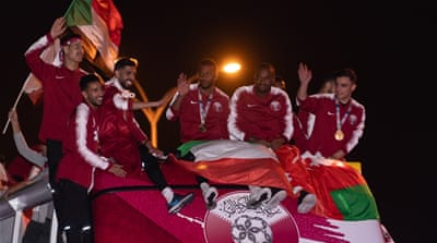 With love and petals, Qatar welcomes its triumphant footballers