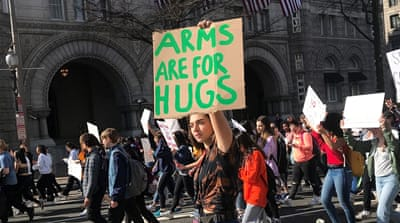 'Arms are for hugs': US students march to end gun violence