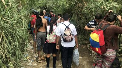 Venezuelan students use risky crossings to get to Colombia school