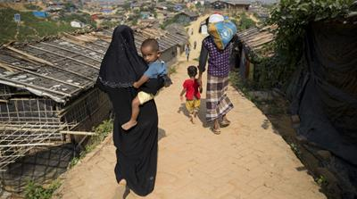 Bangladesh wants to move 100,000 of the Rohingya refugees sheltered in camps to a cyclone-prone island [Dar Yasin/AP]