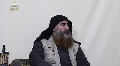 Sitting with an assault weapon, al-Baghdadi gave an 18-minute address and vowed 'more to come' [Al Furqan via AFP]