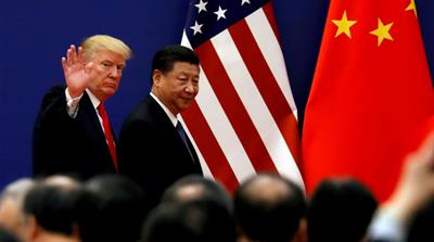 China defiant as Trump adviser admits US consumers pay tariffs