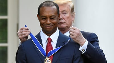 Tiger Woods receives Presidential Medal of Freedom from Trump