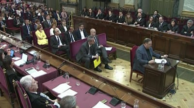 Catalonia separatists begin summer of waiting as trial ends