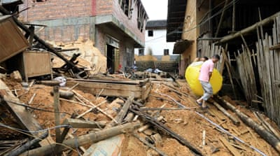 China flood death toll jumps to 61: Ministry