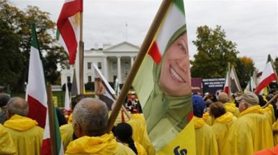 Supporters of Iranian opposition group Mujahedin-e-Khalq hold flags showing Maryam Rajavi, head of the National Council of Resistance of Iran (NCRI) at the White House [Jonathan Ernst/Reuters]