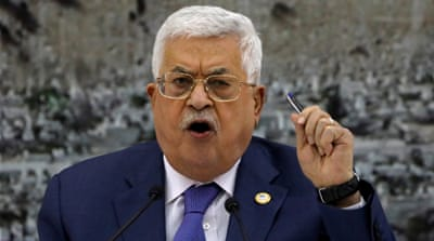 Palestinian president fires advisers, orders return of bonuses