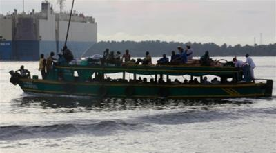 A ferry passes near the port of Abidjan with no weapons. Their mission: to hold the front line against piracy. Picture taken on April 23, 2013. [THIERRY GOUEGNON/REUTERS]
