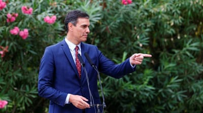 Spain's Sanchez turns left in bid to form government