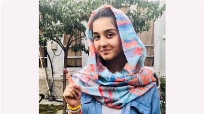 Najmia Popal, 18, a first-time voter [Ali M Latifi/Al Jazeera]